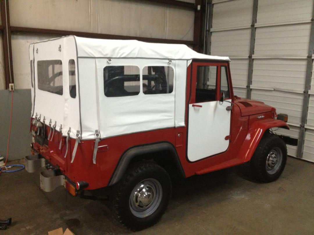 red land cruiser with white top manufactured by Anchor Stitch Marine Upholstery & More