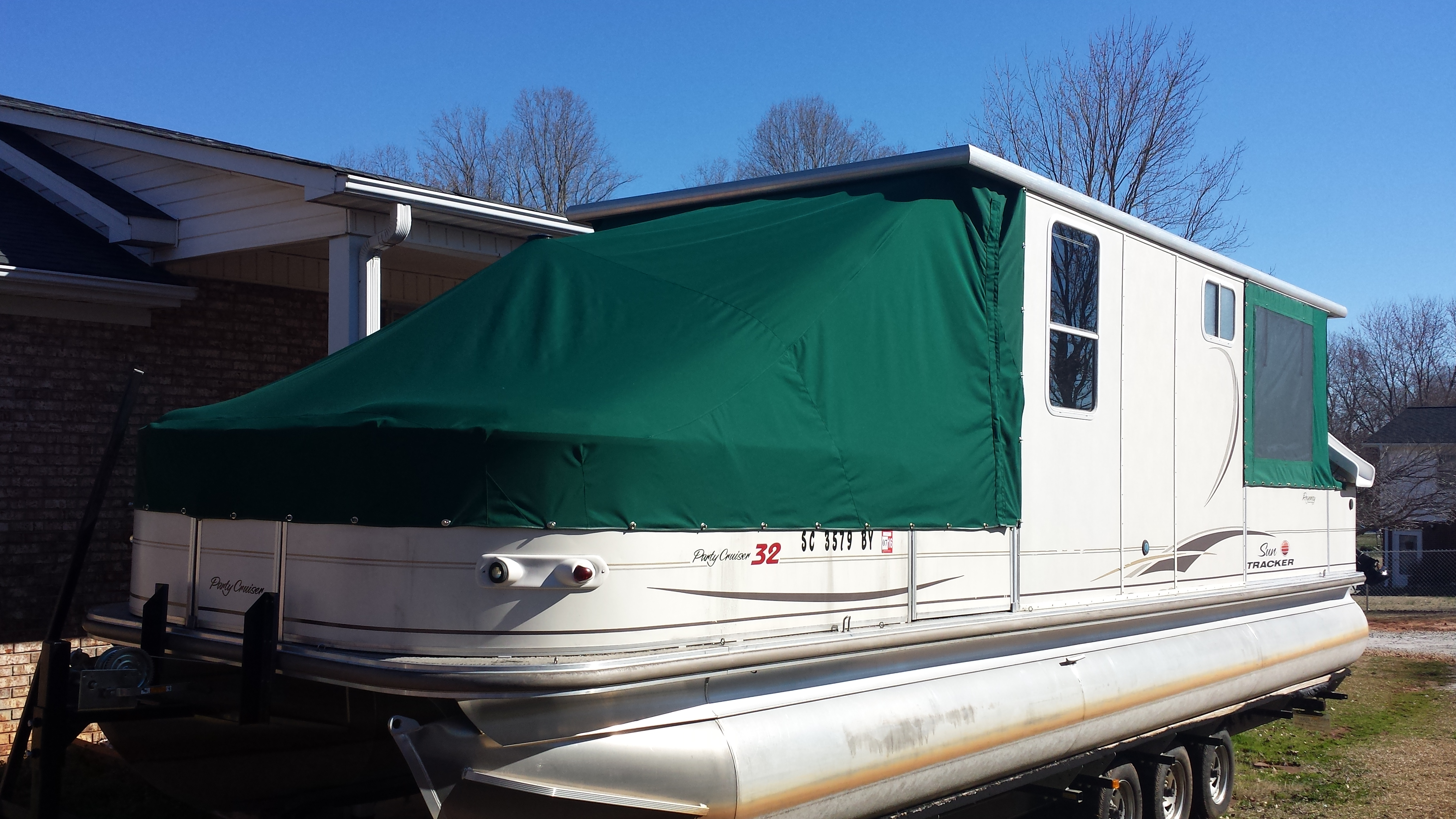 Sun Tracker pontoon enclosure by Anchor Stitch Marine Upholstery & More